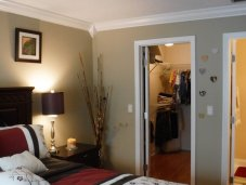 Master bedroom with master bath and walk-in-closet